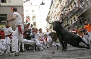 A bull slides upon entering the Estafeta curve during the last running of the bulls in Pamplona